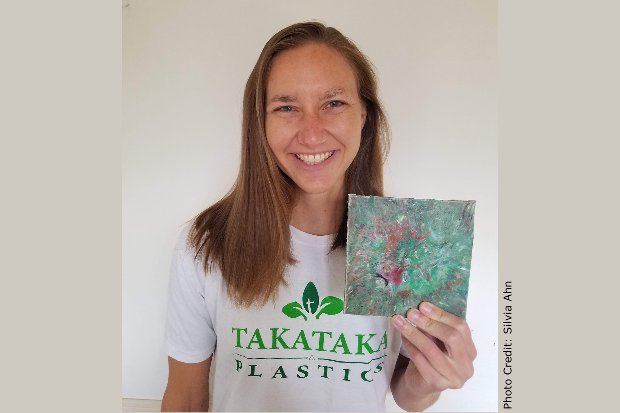 Paige Balcom of University of California, Berkeley with a wall tile made from her machines that convert PET plastic into useable, salable items.