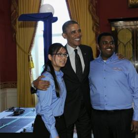 President Obama poses for a photo with Karen Fan and Felege Gebru
